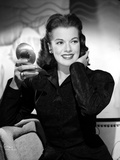 Janis Paige sitting on a Couch in Black Long Sleeve Shirt with Right Hand Holding a Mirror Photo by  Movie Star News