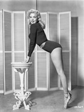 Jayne Mansfield Posed and Bent Over in Black Long Sleeve One Piece Sexy Suit and Silk Waist Belt Photo by Bert Six
