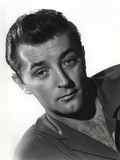 Robert Mitchum Posed in Collared Shirt in Black and White Portrait Photo by  Movie Star News