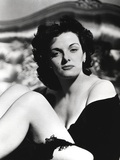 Jane Russell Seated on the Bed in Black Silk Robe with Knees Bent and Arms Crossed Around the Legs Photo by  Movie Star News