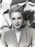 Janet Leigh Posed in Grey V-Neck Long Sleeve Silk Dress and Pearl Earring with Pearl Necklace Photo by  Movie Star News
