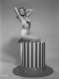 Jayne Mansfield sitting and Knelt on the Stripe Table in White Tube Bra and High Waist Girdle Photo by Bert Six