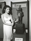 Julie Newmar Holding Hammer with Nail in White Dress Portrait Black and White Photo by  Movie Star News