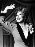Bette Midler Portrait Waving Her Hand in Grey Linen Deep V-Neck Dress Photo by  Movie Star News
