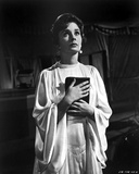 Jean Simmons Posed in White Butterfly Sleeve Silk Dress with Hands Together Holding a Black Book Foto af  Movie Star News
