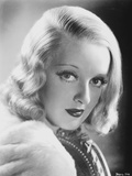 Bette Davis Portrait in White Fur Coat and Black Underclothes in Finger Curl Hairstyle Photo by  Movie Star News