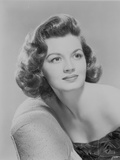 Angie Dickinson Leaning on the Chair and Looking Away in Classic Close Up Portrait Photo by  Movie Star News