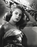 Janet Leigh sitting on the Couch in Strapless Gatherer Bodice Shoulder Dress Photo by  Movie Star News