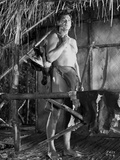 Johnny Weissmuller standing Outside on His House in a Classic Movie Scene Photo by  Movie Star News