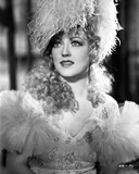 Marion Davies posed in A Portrait wearing A Feather Hat in Black and White Photo by  Movie Star News