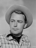 Alan Ladd Looking on the Right wearing a Hat in Close Up Portrait in Classic Photo by  Movie Star News