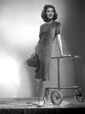 Jean Parker Posed in Grey Short Sleeve Linen Dress and White Shoes with Hands on a Wheeled Table Photo by  Movie Star News