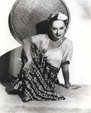 Paulette Goddard Seated on Floor wearing Blouse and Printed Skirt Portrait Photo by  Movie Star News