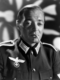 Peter Lorre Smoking Cigarette wearing Rank Official Uniform in Black and White Portrait Photo by  Movie Star News