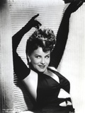 Paulette Goddard Posed with Hands Upwards wearing Sexy Black Outfit with Gloves Photo by  Movie Star News