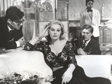 Anita Ekberg sitting on the Couch Listening to a Guy in Classic Portrait Photo by  Movie Star News