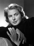 Ingrid Bergman sitting and Leaning on a Couch in a Black Long Sleeve Polo Photo by E Bachrach