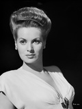 Maureen O'Hara wearing White V-neck Dress in Black Background Photo by E Bachrach