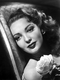 Linda Darnell posed with A Flower in Her Chest in Black and White Photo by  Movie Star News