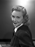 Madeleine Carroll smiling in Black Dress with White Collar Portrait Photo by  Movie Star News