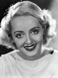 Bette Davis Portrait smiling in White Dress on Black Background Photo by Elmer Fryer