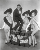 Les Girls Three Woman and a Man Looking Happy in Black and White Photo by  Movie Star News