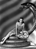 Maria Montez sitting on Snake Statue, wearing Sexy Dress with Pillow Photo by  Movie Star News