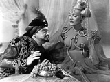 Marlene Dietrich sitting with Man in Detailed Dress with Veil Photo by ER Richee