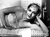 Maria Montez Lying in White Strapless Dress with Headdress Photo by  Movie Star News