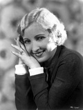 Bessie Love on a Long Sleeve Top smiling and Leaning Face on Hands Photo by  Movie Star News