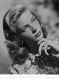Lauren Bacall posed in Floral Dress with Hand on Chin in Black and White Photo by  Movie Star News