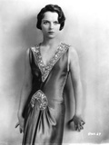 Louise Brooks standing in Black Elegant Dress Portrait Photo by  Movie Star News