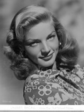 Lauren Bacall smiling in Floral Dress in Black and White Portrait Photo by  Movie Star News