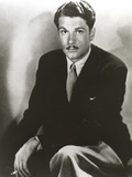 Laurence Olivier sitting in Tuxedo Black and White Portrait Photo by  Movie Star News