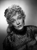 Marlene Dietrich sitting in Elegant Dress with Black Net Sleeves Photo by  Movie Star News