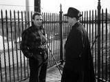 Marlon Brando standing and Talking to a Man Inside a Fence Photo by  Movie Star News