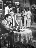 World Of Suzie Wong Man sitting with Woman in Movie Scene Photo by  Movie Star News