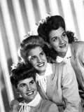 Andrew Sisters smiling and Looking Away in a Group Picture in Classic Photo by  Movie Star News
