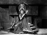 Maria Montez sitting on Snake Statue, wearing Long Classic Gown Photo by  Movie Star News