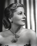 Joan Fontaine wearing Matching Necklace and Earrings in a Portrait Photo by  Movie Star News