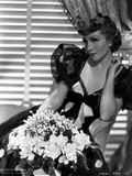Claudette Colbert sitting in Black Elegant Dress with Flowers Photo by ER Richee