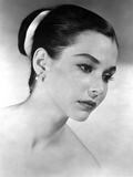 Susan Strasberg wearing an earrings and Harin in Bun Hairdo Photo af  Movie Star News
