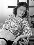 Anne Baxter posed on Floral Dress sitting and smiling Photo by  Movie Star News