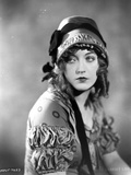 Marion Davies posed in Blouse and Ribbon Hat in Black and White Photo by  Movie Star News