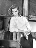 Lauren Bacall Leaning wearing White Sweater in Black and White Photo by  Movie Star News