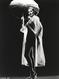 Anita Ekberg wearing a Rain Coat Holding a Umbrella in Classic Portrait Photo by  Movie Star News