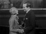 Al Jolson Holding a Woman's Hand While Talking to Her Photo by  Movie Star News