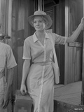 Angie Dickinson standing in Casual Formal Dress Black and White Photo by  Movie Star News