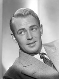 Alan Ladd Leaning Pose wearing a Suit in Black and White Photo by  Movie Star News