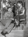 Rose Tattoo Woman Seated on Chair with Man Seated on Floor Photo by  Movie Star News